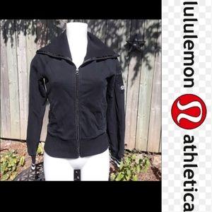 Size S lululemon black an white zip up sweater